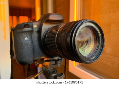 SLR camera on sunset background. Photography concept