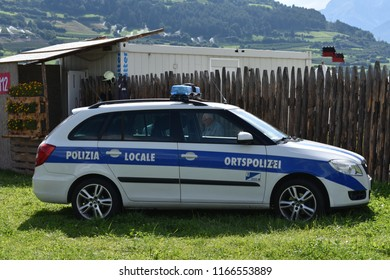 Sluderno, Italy - August 24 2018: Car of the local police parked at the palisade of the Ritterspiele the words 'Local Police' are written on the side in German and Italian