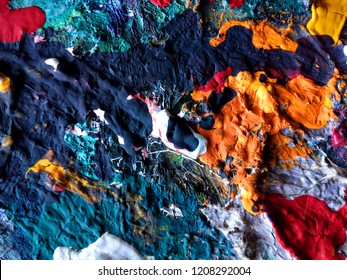sludge colors on the surface of old artist's palette