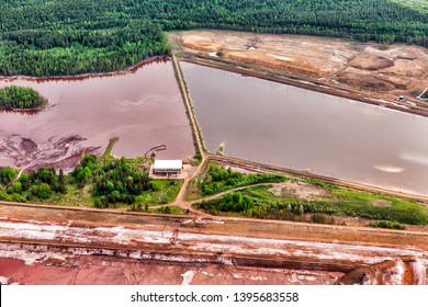 Sludge waste. Dirty blue and green water in reservoir. Environmental pollution. Ecological catastrophy
