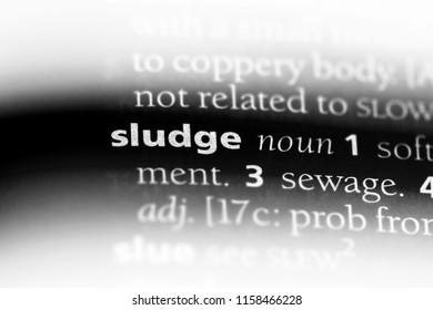 sludge word in a dictionary. sludge concept.