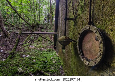 sluice in abandoned factory in the forest
