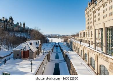Sluice gate on Rideau Canal in winter time in Ottawa, Canada