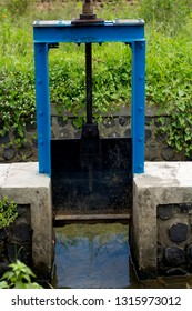 Sluice gate. Small old water sluice gate in the countryside. Blue color
