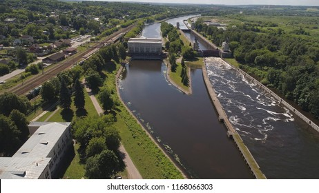 Sluice Gates on the River. Aerial view river sluice construction, water river gateway. Shipping channel on the river.