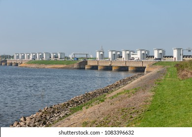 Sluices in Dutch Afsluitdijk near Kornwerderzand for draining fresh water of the lake IJsselmeer to the salt Wadden Sea