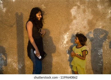 Slum girl Child talking to urban social worker  outside home in Malabar hill area Mumbai city Maharashtra state India clicked on 3rd April 2006