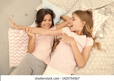 Slumber party concept. Girls just want to have fun. Invite friend for sleepover. Best friends forever. Consider theme slumber party. Slumber party timeless childhood tradition. Girls relaxing on bed.