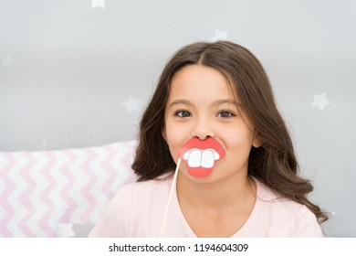 Slumber party photo booth props. Kid girl cheerful posing with toothy mouth lips smile party attribute. Prepare photo booth props hand made or buy for party. Printable photo booth props pajama party.