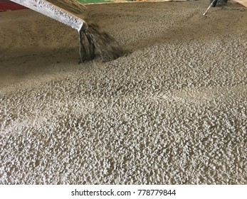 Slump Concrete ready mixed transport from truck to floor or road with building construction