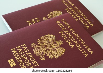 SLUPSK, POLAND – 01 MAY 2018 Passports on the background of the EU flag. Subtitles in Polish