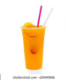 Slush ice with orange in Plastic Cup white background.