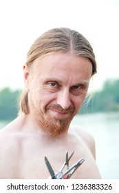 Sly Russian man, blond with beard, red hair, large planom