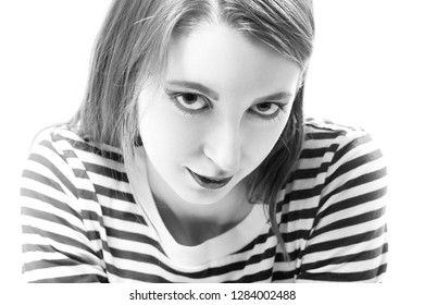 sly young woman smiling looking at camera on white background, monochrome