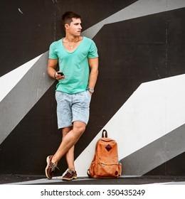 Slylish fashion man traveling with a bag