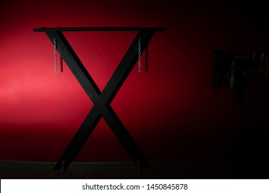 SM cross or Andreaskreuz is used in the scene on red background
