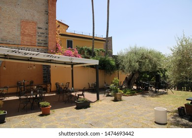 "S.M. di Licodia - Italy / July 7, 2019. This is the garden of Royal Bar, a coffee shop with delicious fruit based ice sludges (""granita""), where in 1414 the Queen of Sicily was in meditation."