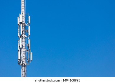 SM. Masts for mobile phone signal. Tower with antennas of cellular communication on the background of blue sky.