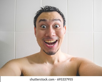 Smaile and happy Asian man take a selfie shot in the bathroom while having bath