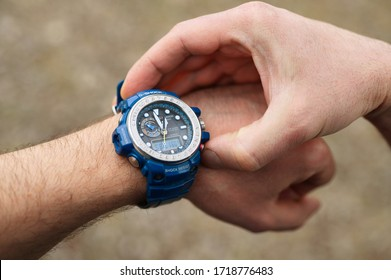Smakhtino / Russia - April 2020: Casio G-shock GWN-1000 watches blue color from the electronics manufacturer company Casio. Men's wrist watch on the male hand of a traveler who is on a trip