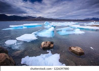 Smal icebergs floating near Qikiqtarjuaq, Nunavut, Canada