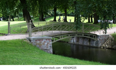 smal iron bridge in a park