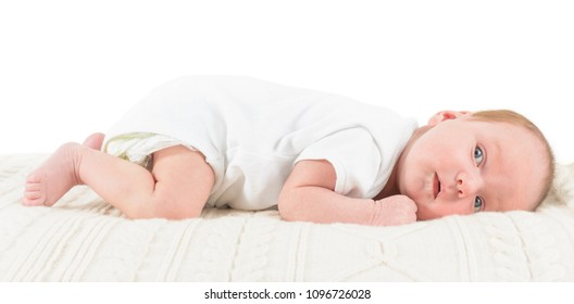 small 1 month baby lies on the stomach