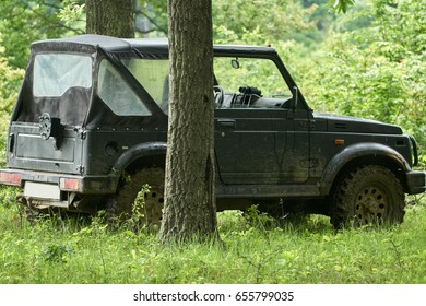 Small 4x4 offroad car in the forest