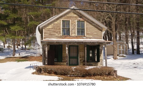Small abandoned house in the winter season.