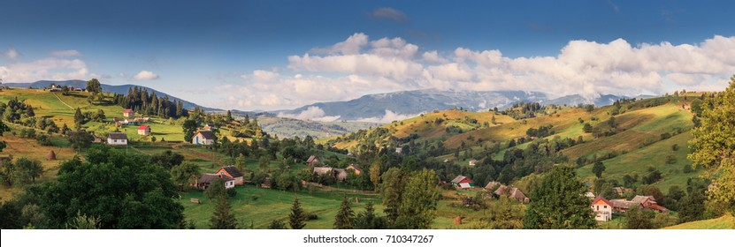 A small abandoned house in the woods and Sibillini mountains in the distance in Italy