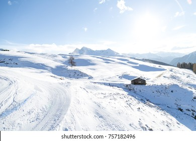 Small abandoned hut in the middle of nowhere covered of snow at the mountains. Davos Switzerland.