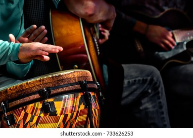 A small acoustic band performing tunes on a street in the District of Columbia.