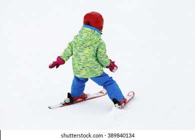 small active child skiing on snow slope, active lifestyle