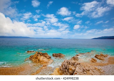 Small Adriatic coastline Croatia. Clear azure water under blue sky.