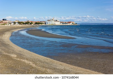 The small adriatic town and seaside resort of Grado, Italy, seen from the beach