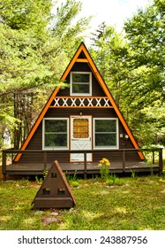 small A-Frame cabin in the woods