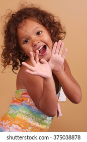 Small African American girl striking a happy pose