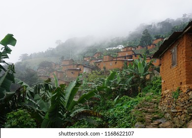 Small african village with houses of loam on the mountain between banana trees on the mount agou in Togo