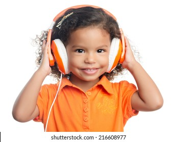 Small afro american girl with curly hair listening music on bright orange headphones