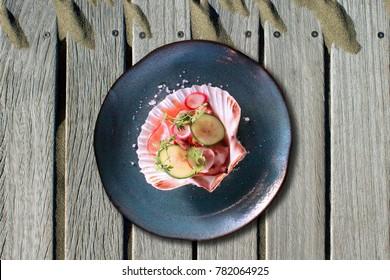 Small aguachile ceviche inside a scallop