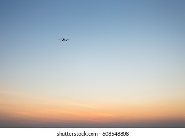 The small aircraft on a golden evening sky