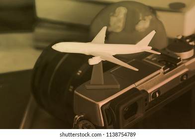 Small airplan on camera , travel preparation concept