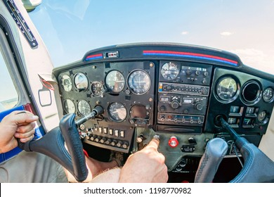 Small Airplane control panel (cockpit) in flight.