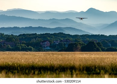 Small airplane lifting of a grass airfield near Zagreb, Croatia.