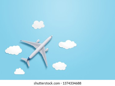 Small airplane model on the blue background with copy space