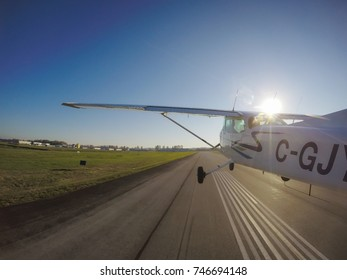 Small airplane is taking off from a runway during a bright sunny day. Taken in Pitt Meadows, Greater Vancouver, British Columbia, Canada.