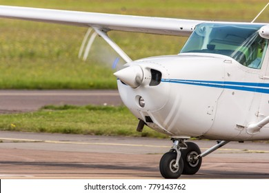 Small airplane while driving at the airport with rotating propeller