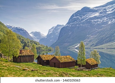 Small alpine settlement on Lovatnet in front of the mighty glaciers of Jostedalsbreen