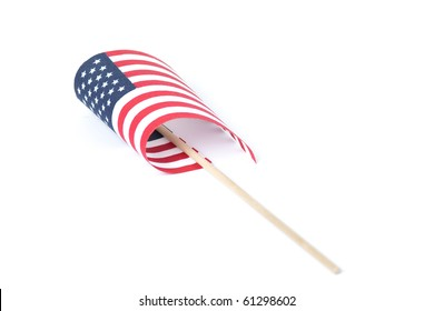 Small American flag on carrying handle, partially curled up. Shot on a white background.