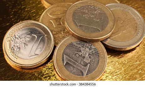 A small amount of money. Euro. Coins one and two euros on a mirrored background